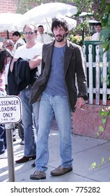 Keanu Reeves looking more like a homeless person than a movie star, smoking after lunch at the Ivy, West Hollywood, Ca, 06/23/04