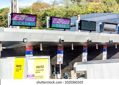 Kearny, USA - October 27, 2017: EZPass EZ Pass Cash lane for toll to bridge on New York City, NYC, prices, lane restrictions, Hertz truck