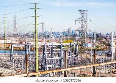 Kearny, USA - October 27, 2017: Industrial factory truck shipping complex JF Lomma Trucking and Rigging in New Jersey with cityscape skyline of Manhattan, New York City, during day