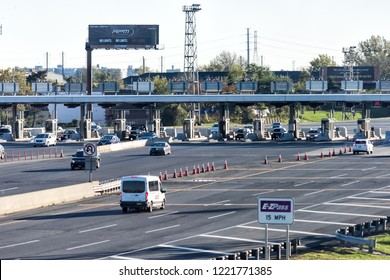 Kearny, USA - October 27, 2017: EZPass EZ Pass Cash lane, toll road to bridge in New York City, NYC with prices, restrictions sign and trucks