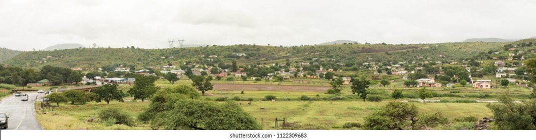 KEATES DRIFT, SOUTH AFRICA - MARCH 22, 2018: A view, with a road bridge, buildings and vehicles visible, of Keates Drift in the Kwazulu-Natal Province