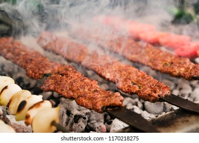 Kebab is cooking in grill. Kebap is traditional Turkish food. Closeup photo.