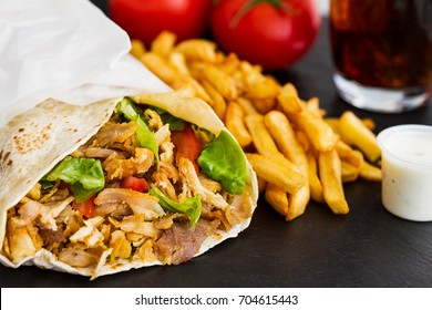 Kebab and french fries with soda