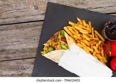 Kebab and french fries with soda top view