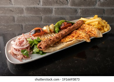kebab, the most important dish of arab and turkish culture, Marinating beef and lamb meat and cooking on embers and presenting with garnish