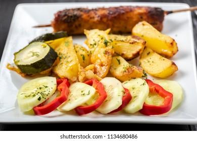 kebab on sticks served with roasted vegetables