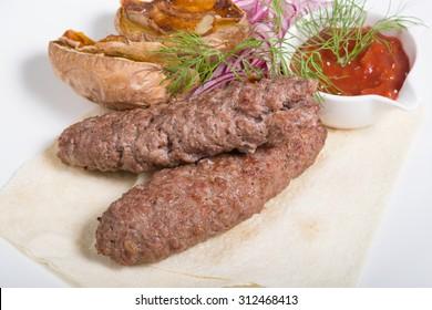 Kebab with potato garnish
