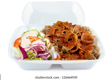 Kebab with salad take-out food in plastic box, isolated on white with shadow