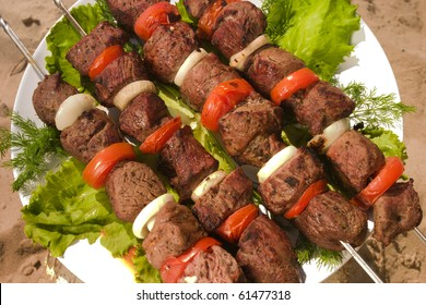kebab with tomato and pommels on the plate