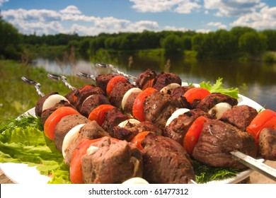 kebab  with tomato and pommels at the river