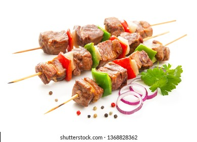Kebabs - grilled meat and vegetables on skewers. Isolated on white