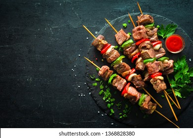 Kebabs - grilled meat and vegetables on skewers
