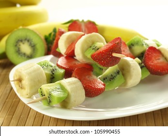 Kebabs with pieces of strawberry, banana and kiwi