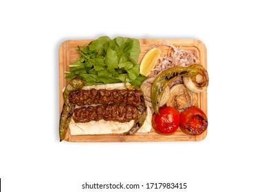 kebabs, tomatoes, onions and greens on a wooden dish - kebap