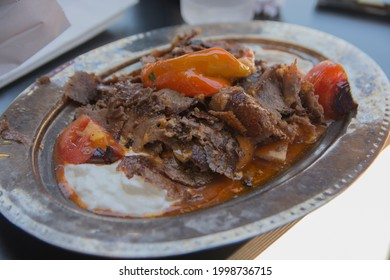 İskender kebap, one of the most popular dishes of Turkey, thinly and carefully cut grilled lamb topped with hot tomato sauce over pieces of pita bread