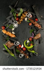 Kebap, roasted meat and vegetables on grill
