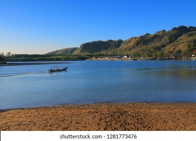Kebumen, Central java, Indonesia - August 19, 2018: Fisherman at ayah beach, Kebumen Regency, Central Java, Indonesia.