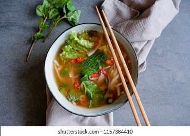 Kedah famous hawker's food / Laksa Kedah / Dish of rice noodle fish based asam gravy soup garnished with shredded cucumber and onions with aromatic herbs fragrance, sweetness of fish and spicy broth