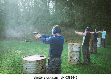 KEDAH, KULIM, MALAYSIA - FEBRUARY 10, 2018 A Man training shooting target with gun at shooting range