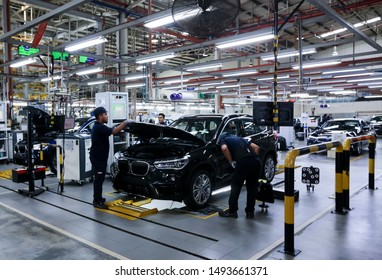 KEDAH, MALAYSIA - JULY 04, 2019 : Workers doing final inspection on cars at automobile assembly line production plant. Automotive & technology for domestic and export markets industry.
