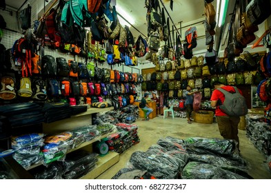 Kedah, Malaysia - July 14, 2017: Bag shop at Malaysian Thailand border offer a variety of high quality product from a small bag until a large bag for hikers and backpackers.
