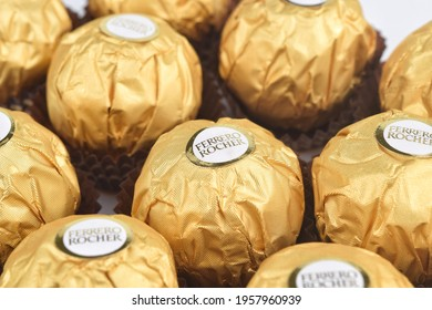 Kedah, Malaysia-Circa April 2021: Ferrero Rocher chocolate isolated in white background. Ferrero Rocher is chocolate and hazelnut manufacturers by Italian company. Food concept. Selective focus image.