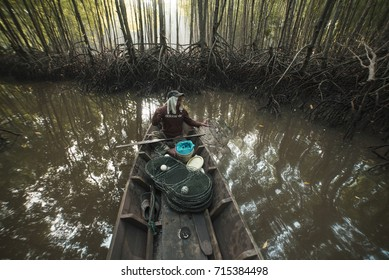 KEDAH STATE, MALAYSIA, 14 SEPTEMBER 2017: The fisherman is on a boat to go out to catch crabs and fish to sell.