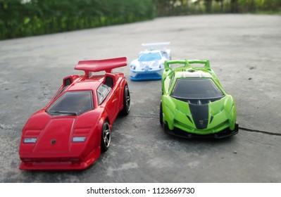 Kediri, Indonesia - June 30, 2018 : Hotwheels diecast model car. Hotwheels diecast made in Malaysia. This is Lamborghini Countach, Lamborghini Veneno and 2016 Ford GT Race diecast car.