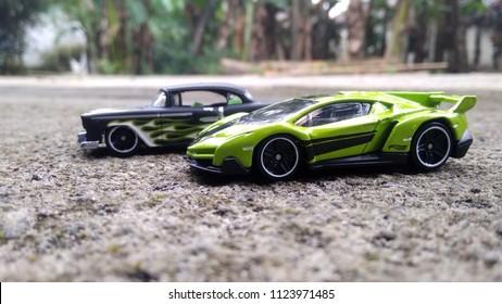 Kediri, Indonesia - June 30, 2018 : Hotwheels diecast model car. Hotwheels diecast made in Malaysia. This is Lambhorgini Veneno and 55 Chevy diecast car.