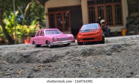 Kediri, Indonesia - September 02, 2018 : Hotwheels diecast model car. Hotwheels diecast made in Malaysia. This is Fiat 500 and The Simpsons family car diecast car.