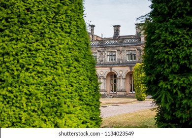 Keel University, Staffordshire, UK - Circa July 2018: Abstract image of part of the grand hall at a leading University shown together with part of a privet hedge seen in the large grounds.