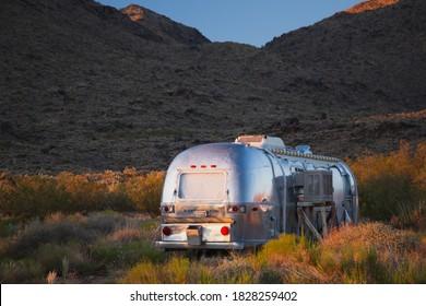 KEELER, CA - OCTOBER 5, 2020: Airstream RV at sunset on a desert
