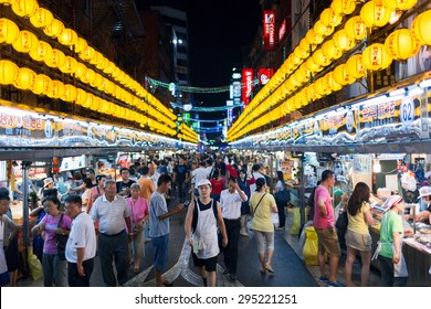 KEELUNG, TAIWAN - 19 SEPTEMBER 2014: Keelung Miaokou night market, famous throughout Taiwan for its large selection of affordable food