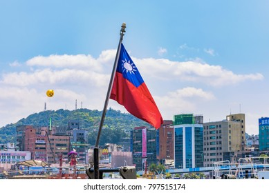KEELUNG, TAIWAN - APRIL 04: This is Taiwanese national flag in the port of Keelung with harbor buildings in the background on April 04, 2017 in Keelung
