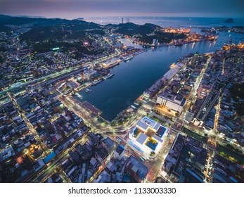 Keelung, Taiwan - June 26, 2018: Keelung city is a major port city situated in the northeastern part of Taiwan. Port city concept image. Panoramic cityscape birds eye view use the drone in evening.