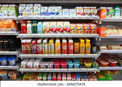 KEELUNG, TAIWAN - NOVEMBER 24, 2018: Milk drinks, yoghurts and juices selection at a convenience store refrigerator in Keelung, Taiwan.