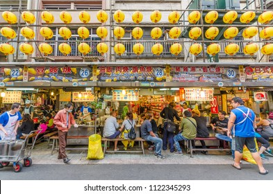 Keelung,Taiwan - March 18,2015 : Keelung Miaokou night market famous throughout Taiwan for its large selection of food.People can seen walking and exploring around it.