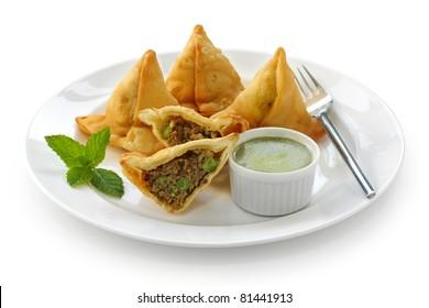 keema samosa with fresh mint dipping sauce , indian food