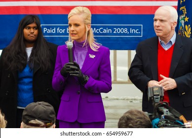 KEENE, NEW HAMPSHIRE/US - JANUARY 7, 2008: US Senator John McCain's wife, Cindy, speaks at a rally on the day before the 2008 New Hampshire presidential primary. Left, the McCains' daughter, Bridget.