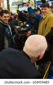 KEENE, NEW HAMPSHIRE/US - JANUARY 7, 2008: US Senator John McCain jokingly looks for a way through reporters during a rally on the final day before the 2008 New Hampshire presidential primary.