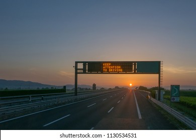 Keep attention to driving written on highway road sign