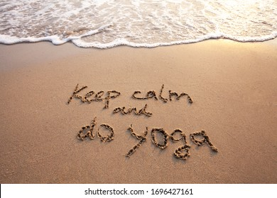 keep calm and do yoga, text on sand