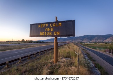 Keep calm and drive on light up board on highway