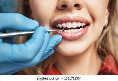 Keep calm and smile. Teen at the dental office. Dentist examining girl's teeth in clinic.