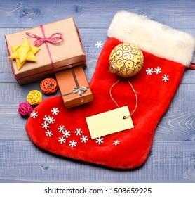 Keep family traditions. Stocking stuffers idea. Stocking with christmas gift box. Christmas sock toned wood background top view. Traditional christmas attribute. Christmas stocking sock shaped bag.
