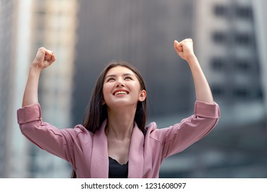 Keep filghting, Young pretty woman raised hands up celebrate success in job or great news, You can do it, keep fighting.