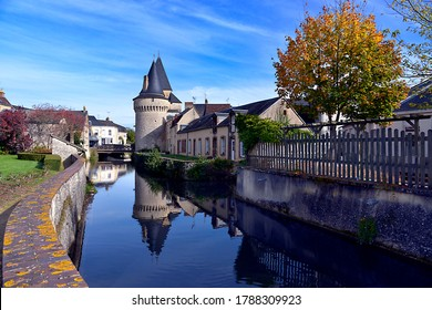 Keep of the fortified gate Saint-Julien on the Huisne river with big reflection at La-Ferté-Bernard, a commune in the Sarthe department in the Pays de la Loire region in north-western France