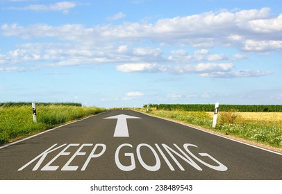 Keep Going - Business concept with street and arrow