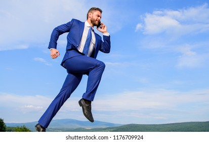 Keep going towards your goal. Businessman formal suit jump while call smartphone sky background. Entrepreneur in motion success expression. Businessman solving business problems on phone. Never stop.