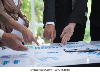 Keep up the Hands of Business people who are discussing and brainstorming about market statistics and quarterly sales.business meeting team concept
